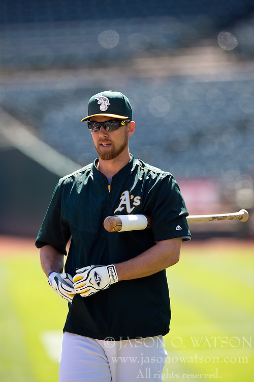 OAKLAND, CA - JUNE 21:  Ben Zobrist #18 of the Oakland Athletics holds a bat during batting practice before the game against the Los Angeles Angels of Anaheim at O.co Coliseum on June 21, 2015 in Oakland, California. The Oakland Athletics defeated the Los Angeles Angels of Anaheim 3-2. (Photo by Jason O. Watson/Getty Images) *** Local Caption *** Ben Zobrist