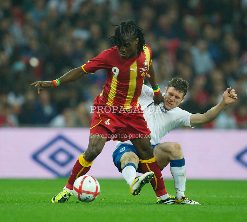 LONDON, ENGLAND - Tuesday, March 29, 2011: England's James Milner in action against Ghana's Derek Boateng during the international friendly match at Wembley Stadium. (Photo by David Rawcliffe/Propaganda)