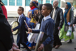 "Westminster, London, March 25th 2016. Westminster's annual interdenominational Easter procession takes place with a procession from Methodist Central Hall to Westminster Cathedral and then on to Westminster Abbey, with the cross borne by people from The Passage, a homeless charity. PICTURED: Their drums beating ""as Jesus' heart"", two children from St Vincent de Paul Primary School in Victoria. <br /> ©Paul Davey<br /> FOR LICENCING CONTACT: Paul Davey +44 (0) 7966 016 296 paul@pauldaveycreative.co.uk"