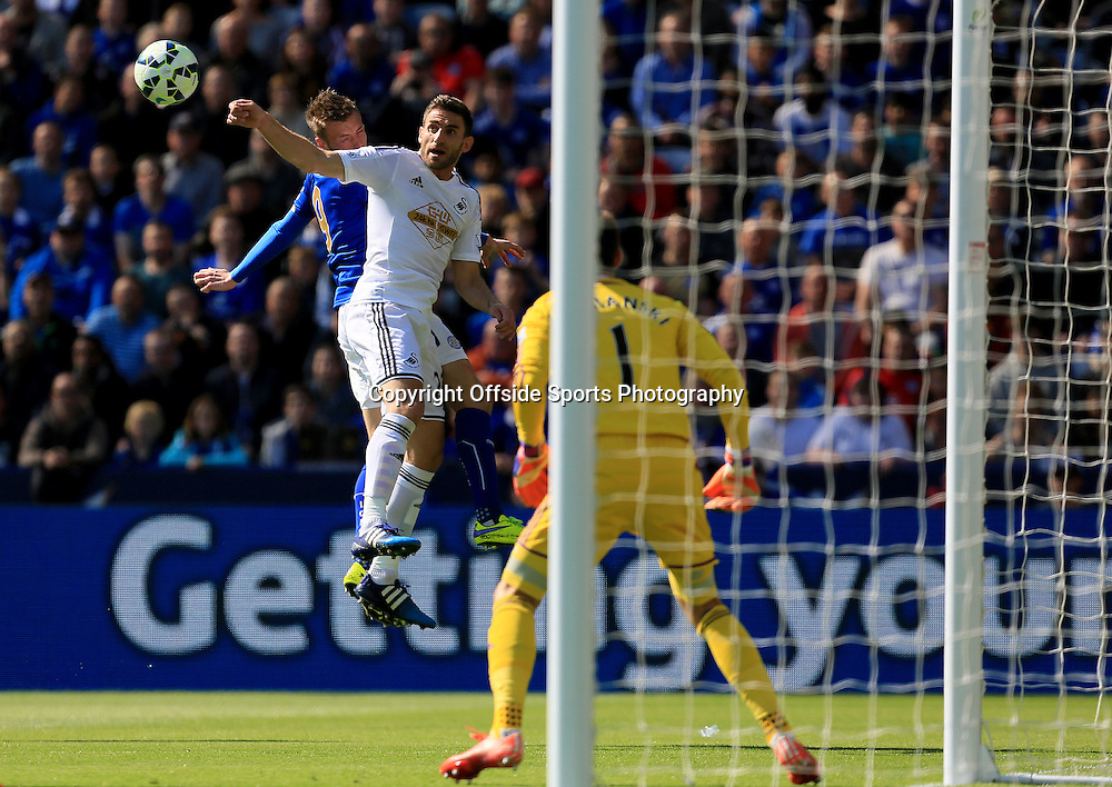 18th April 2015 - Barclays Premier League - Leicester City v Swansea - Angel Rangel of Swansea City wins a header from Jamie Vardy of Leicester City - Photo: Paul Roberts / Offside.