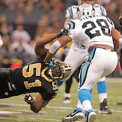 2008 December, 28: New Orleans Saints linebacker Jonathan Vilma (51) grabs Carolina Panthers running back Jonathan Stewart (28) during a week 17 game between NFC South divisional rivals the Carolina Panthers and the New Orleans Saints at the Louisiana Superdome in New Orleans, LA.
