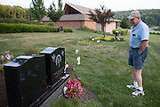 Ralph Paladino visits his daughter's grave in Utica, NY on September 3, 2015. Deanna died in 2014 at age 41. The Paladinos live primarily on Ralph's police officer's pension and social security, and have home equity loan with an interest rate linked to the prime lending rate. A Fed rate increase would force their already tight budget even further. Photographer: Mike Bradley/Bloomberg