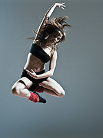 beautiful young caucasian woman girl dancer ballet breakdance leap jump on studio isolated background