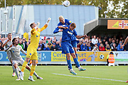 AFC Wimbledon striker Joe Pigott (39) and AFC Wimbledon attacker Marcus Forss (15) battles for possession with Portsmouth goalkeeper Craig MacGillivray (1)during the EFL Sky Bet League 1 match between AFC Wimbledon and Portsmouth at the Cherry Red Records Stadium, Kingston, England on 19 October 2019.