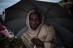 In a refugee camp,Ukhia, Bangladesh. An old Rohingya woman is waiting for food supplies.<br />