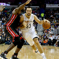 Oct 23, 2013; New Orleans, LA, USA; New Orleans Pelicans power forward Ryan Anderson (33) drives past Miami Heat center Greg Oden (20) during the first half of a preseason game at New Orleans Arena. Mandatory Credit: Derick E. Hingle-USA TODAY Sports