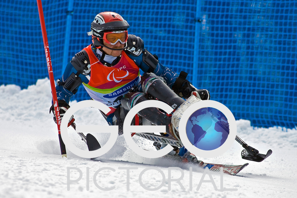 SESTRIERE COLLE, ITALY - MARCH 19th : Roger Lee of the USA in the mens Alpine Skiing Slalom Sitting competition on Day 10 of the 2006 Turin Winter Paralympic Games on March 19th, 2006 in Sestriere Borgata, Italy.