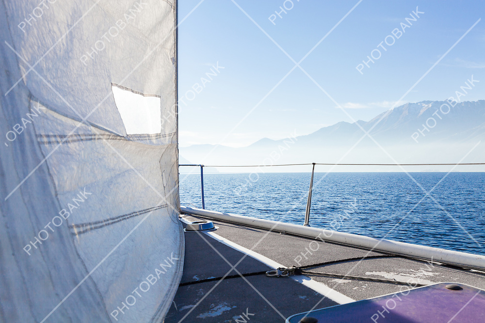 Sailing boat in sunny day in the lake, lonely