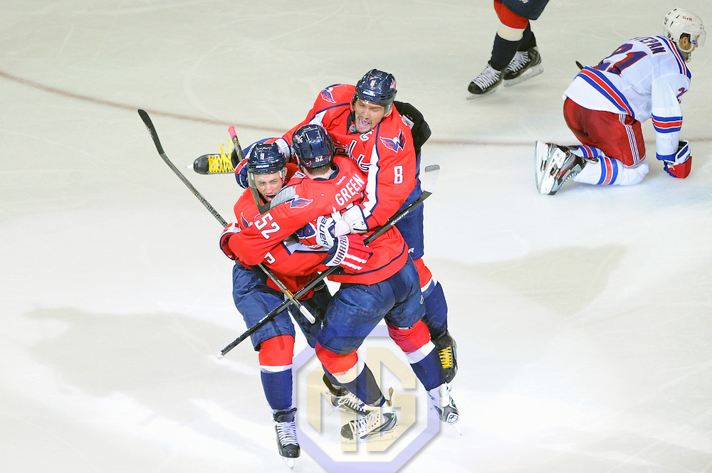 04 May 2013:  Washington Capitals defenseman Mike Green (52) is congratulated by center Mike Ribeiro (9) and left wing Alex Ovechkin (8) after scoring the game winning power play goal in overtime against the New York Rangers at the Verizon Center in Washington, D.C. where the Washington Capitals defeated the New York Rangers, 1-0 in overtime in game two of the Eastern Conference Quarterfinals.