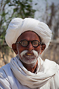 Indian Bishnoi Hindu man at Bishnoi village near Rohet in Rajasthan, Northern India