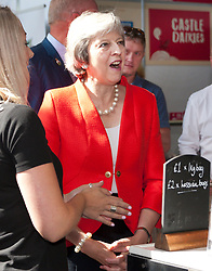 © Licensed to London News Pictures. 26/07/2018. Llanelwedd, Powys, UK. Prime Minister Theresa May visits the Royal Welsh Agricultural Show. The Royal Welsh Agricultural Show is hailed as the largest & most prestigious event of its kind in Europe. In excess of 200,000 visitors are expected this week over the four day show period. The first ever show was at Aberystwyth in 1904 and attracted 442 livestock entries. Photo credit: Graham M. Lawrence/LNP