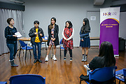 """Phobsuk """"Dang"""" Gasing, a migrant domestic worker and migrant workers' rights activist, gives a talk at an event on how migrant domestic workers and their employers get along with each other in Wan Chai, Hong Kong SAR on December 16, 2018. Gasing has been a domestic worker for 27 years and is also an executive committee member of the International Domestic Workers Federation (IDWF) and chairperson of the Hong Kong Federation of Asian Domestic Workers Unions (FADWU) and Thai Migrant Workers Union (TMWU).<br /> Photo by Suzanne Lee/PANOS Pictures for Open Society Foundation"""