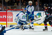 KELOWNA, CANADA - OCTOBER 23:  Andrew Fyten #26  tries to block a shot on Joel Hofer #30 of the Swift Current Broncos during second period against the Kelowna Rockets on October 23, 2018 at Prospera Place in Kelowna, British Columbia, Canada.  (Photo by Marissa Baecker/Shoot the Breeze)