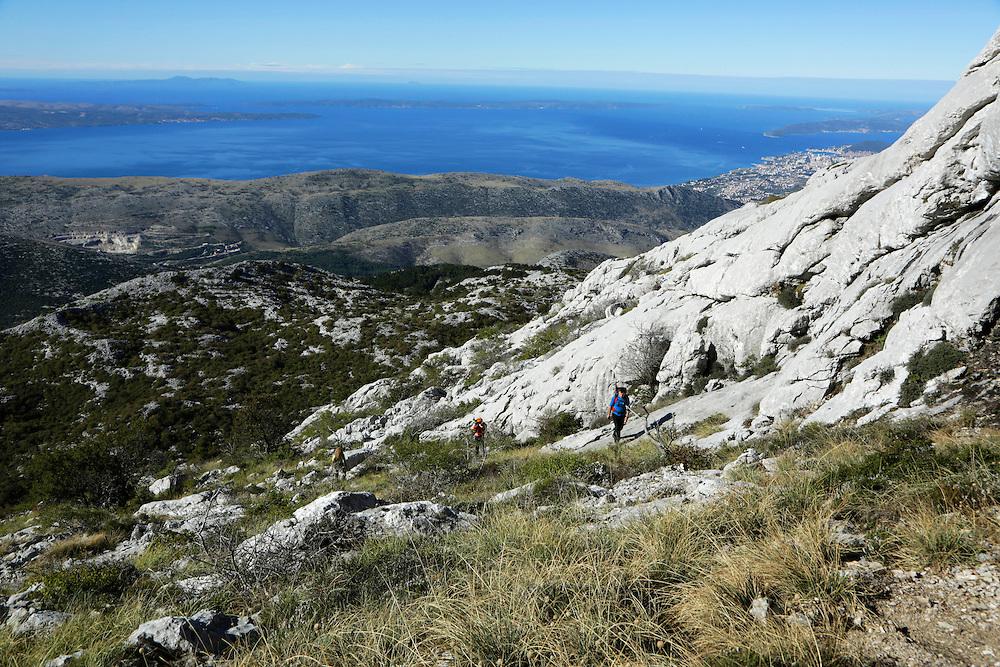 Via Dinarica team arriving to the ridge of Mosor mountain, Croatia.