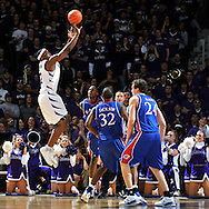 Jan 30, 2008; Manhattan, KS, USA; Kansas State Wildcats forward Bill Walker (12) hits a jump shot over Kansas Jayhawks defenders Darnell Jackson (32) and Sasha Kaun (24) in the first half at Bramlage Coliseum in Manhattan, KS. Mandatory Credit: Peter G. Aiken-US PRESSWIRE