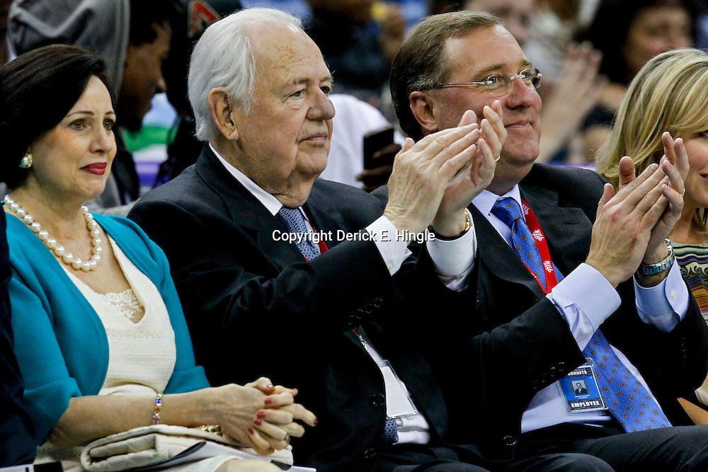 October 9, 2012; New Orleans, LA, USA; New Orleans Hornets  and Saints owners Gayle Benson and Tom Benson along with Saints and Hornets president President Dennis Lauscha watch courtside during the third quarter of a preseason game against the Charlotte Bobcats at the New Orleans Arena. The Hornets defeated the Bobcats 97-82.  Mandatory Credit: Derick E. Hingle-US PRESSWIRE