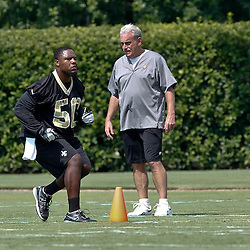 June 5, 2012; Metairie, LA, USA; New Orleans Saints assistant head coach Joe Vitt watches linebacker Curtis Lofton (50) during a minicamp session at the team's practice facility. Mandatory Credit: Derick E. Hingle-US PRESSWIRE