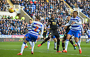Bolton wanderers striker Shola Ameobi has a header at goal saved by Reading goalkeeper Ali Al Habsi during the Sky Bet Championship match between Reading and Bolton Wanderers at the Madejski Stadium, Reading, England on 21 November 2015. Photo by Adam Rivers.