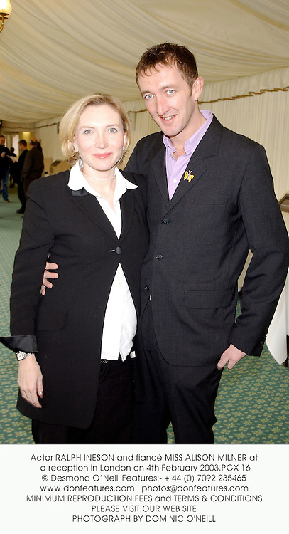 Actor RALPH INESON and fiancŽ MISS ALISON MILNER at a reception in London on 4th February 2003.	PGX 16