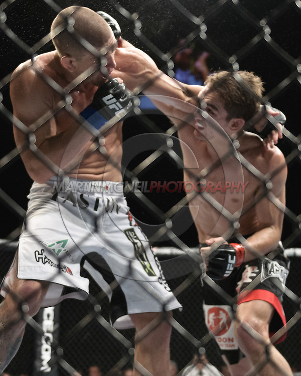 """LONDON, ENGLAND, OCTOBER 2010: Mike Pyle (left) and John Hathaway trade blows during """"UFC 120: Bisping vs. Akiyama"""" inside the O2 Arena in Greenwich, London"""