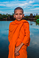 Novice  Buddhist monk, Angkor Wat, the largest religious monument in the world (means City which is a Temple); Cambodia.