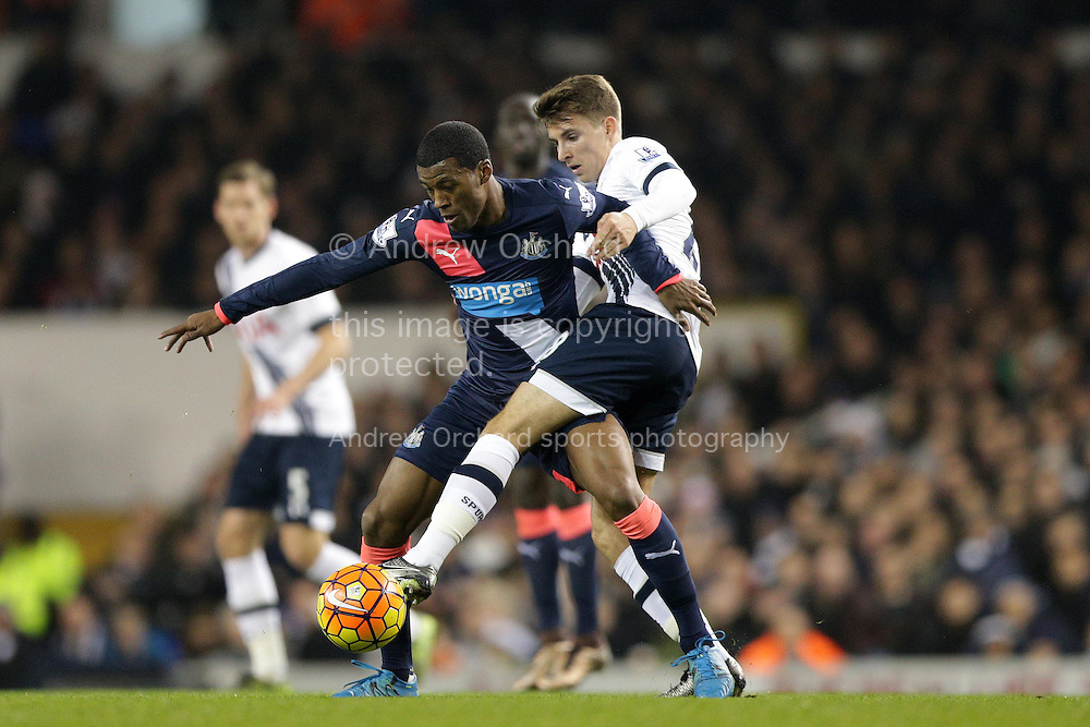 Georginio Wijnaldum of Newcastle United blocks the ball from Tom Carroll of Tottenham Hotspur. Barclays Premier league match, Tottenham Hotspur v Newcastle Utd at White Hart Lane in London on Sunday 13th December 2015.<br /> pic by John Patrick Fletcher, Andrew Orchard sports photography.