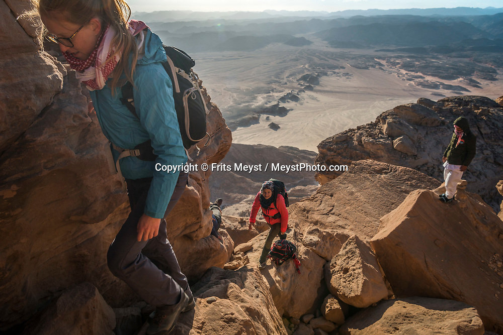 Sinai, Egypt, December 2018. Sunrise at Jebel Mileihis mountain, while hiking with the Tarabin Tribe through the Sinai Desert Coastal Ranges. The Sinai Trail is Egypt's 1st long distance hiking trail, running 230km from the Gulf of Aqaba to the top of the Sinai's highest mountain. It connects old trade, travel and pilgrimage routes through one of the Middle East's most iconic desert wildernesses and is managed by a cooperative of three Bedouin tribes. Photo by Frits Meyst / MeystPhoto.com