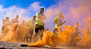 Participants follow a smoke trail as the World's Toughest Mudder 2014 begins about Lake Las Vegas on Saturday, November 15, 2014. L.E. Baskow