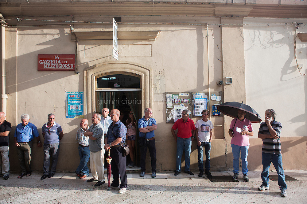 GRASSANO, ITALY - 24 JULY 2014: Local residents wait for Mr de Blasio to come out of the city council after receiving a honorary citizenship in Grassano, his ancestral home town in Italy, on July 24th 2014.<br /> <br /> New York City Mayor Bill de Blasio arrived in Italy with his family Sunday morning for an 8-day summer vacation that includes meetings with government officials and sightseeing in his ancestral homeland.