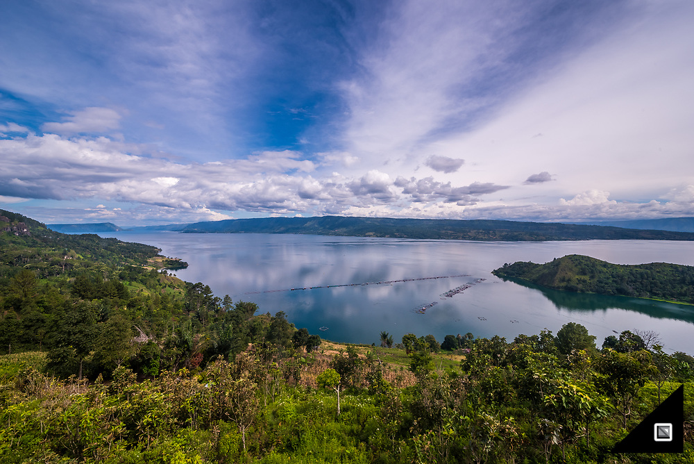 Lake Toba is located in the middle of the northern part of the Indonesian island of Sumatra. The large natural lake is the site of a massive supervolcanic eruption, now occupying the caldera. Lake Toba is about 100 kilometres long and roughly 30 kilometres wide, which makes it the largest volcanic lake in the world. One may not believe, but the lake is up to 505 metres deep.