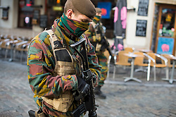"© Licensed to London News Pictures. 23/11/2015. Brussels, Belgium. Belgian military walk past An empty restaurant at lunchtime on a deserted street in central Brussels where the city is currently on ""lockdown"" amid ""imminent threat"" of Paris-style bomb and gun attacks. Photo credit: Ben Cawthra/LNP"
