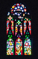 Milan, Italy, Duomo Cathedral. Stained glass window. Depictions of animals, saints  and biblical themes.