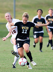 VCU Rams midfielder Stephanie Power (22) fends off Virginia Cavaliers forward Maggie Kistner (16).  The Virginia Cavaliers defeated the VCU Rams 5-0 in women's soccer at Klockner Stadium on the Grounds of the University of Virginia in Charlottesville, VA on August 31, 2008.