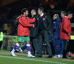 Bristol City's Korey Smith shake hands with Bristol City manager, Steve Cotterill as he comes off the pitch. - Photo mandatory by-line: Alex James/JMP - Mobile: 07966 386802 - 10/03/2015 - SPORT - Football - Yeovil - Huish Park - Yeovil Town v Bristol City - Sky Bet League One