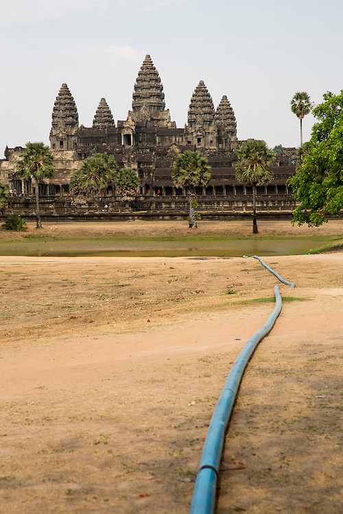 A water pipe draining into the lake beside the ancient Angkor Wat temple, Siem Reap, Cambodia.  Angkor Wat is one of UNESCO's world heritage sites. It was built in the 12th century and covers 162 hectares.  It is Cambodia's main tourist attraction.  (photo by Andrew Aitchison / In pictures via Getty Images)