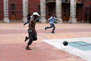 Street boys play against students from the Knowledge is Virtue Academy at the Drill Hall in Johannesburg on 3 November 2009.   The concrete surface wears out the ball and it has to be replaced after two weeks. More importantly, playing together builds self-confidence and team spirit.
