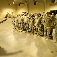 Memebers of the 155th Headquarters Headquarters Company recieve a few last minute details before they depart for Fort Bliss to begin their training for their upcoming deployment to the Middle East.