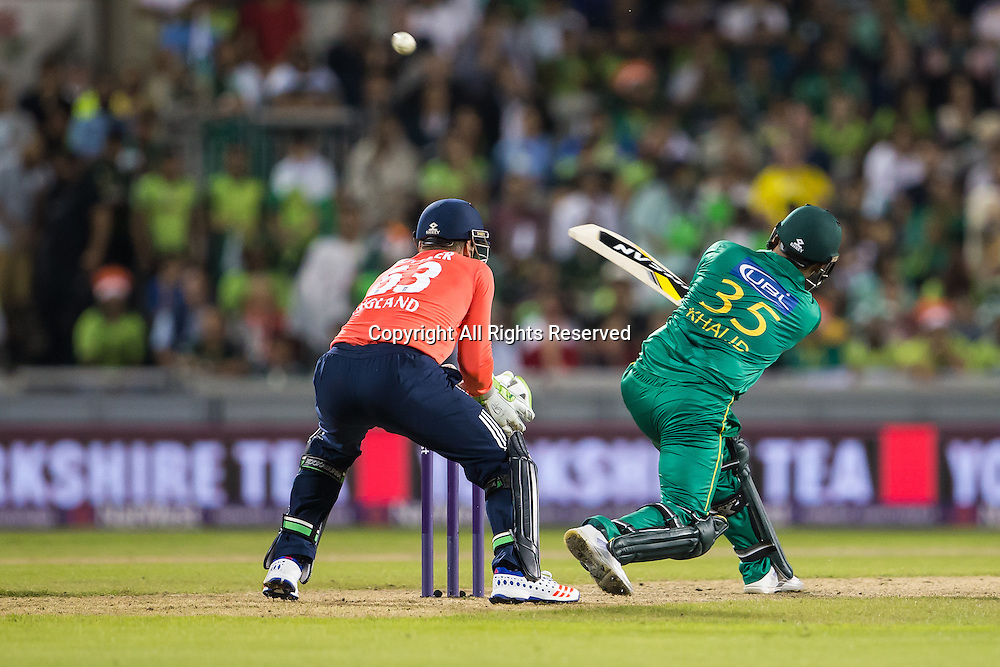 07.09.2016. Old Trafford, Manchester, England. Natwest International T20 Cricket. England Versus Pakistan. Pakistan batsman Khalid Latif hits to the boundary watched by England wicketkeeper Jos Buttler.
