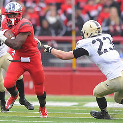 10 November 2012: Rutgers Scarlet Knights running back Savon Huggins (28) rushes the ball past Army Black Knights linebacker Alex Meier (23) during NCAA college football action between the Rutgers Scarlet Knights and Army Black Knights at High Point Solutions Stadium in Piscataway, N.J.. Rutgers defeated Army 28-7.