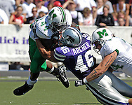Kansas State linebacker Brandon Archer (46) wraps up Marshall running back Ahmad Bradshaw (44) in the first half at Bill Snyder Family Stadium in Manhattan, Kansas, September 16, 2006.  The Wildcats beat the Thundering Herd 23-7.
