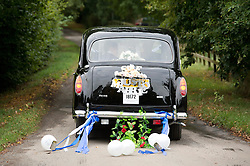 © London News Pictures. 14/09/2013.  The bride and groom leaving the church in a black cab after the wedding. The wedding of Euan Blair, Son of former British Prime Minister Tony Blair,  to Suzanne Ashman at All Saints Parish Church in Wotton Underwood, Buckinghamshire. The wedding was attended by Former British Prime minister Tony Blair and his wife Cherie Blair. Photo credit: Ben Cawthra/LNP