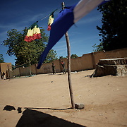 January 21, 2013 - Diabaly, Mali: Mali army men patrol central Diabaly, a day after Mali government troops regain control of the city. Diabaly was under islamist militants control since the 14th of January.<br /> <br /> Several insurgent groups have been fighting a campaign against the Malian government for independence or greater autonomy for northern Mali, an area known as Azawad. The National Movement for the Liberation of Azawad (MNLA), an organisation fighting to make Azawad an independent homeland for the Tuareg people, had taken control of the region by April 2012.<br /> <br /> The Malian government pledge to the French army to help the national troops to stop the rebellion advance towards the capital Bamako. The french troops started aerial attacks on rebel positions in the centre of the country and deployed several hundred special forces men to counter attack the advance on the ground. (Paulo Nunes dos Santos/Polaris)