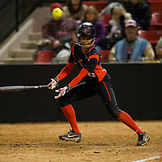 02 March 2018: San Diego State softball closes out day two of the San Diego Classic I at Aztec Softball Stadium with a night cap against CSU Northridge. San Diego State outfielder Aris Metcalfe (00) hits a single in the bottom of the third inning. The Aztecs dropped a close game 2-0 to the Matadors. <br /> More game action at sdsuaztecphotos.com