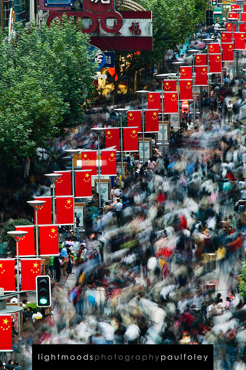 Lone man standing still in vast moving crowd, Nanjing Donglu, Shanghai, during Autumn Moon Festival. Fine Art Photography, Paul Foley, Collectible Photography