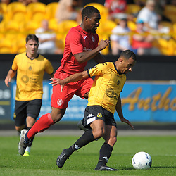TELFORD COPYRIGHT MIKE SHERIDAN Andre Brown of Telford tussles with Russell Benjamin of Southport(formerly of AFC Telford) during the National League North fixture between Southport and AFC Telford United at Haig Avenue on Saturday, August 24, 2019<br /> <br /> Picture credit: Mike Sheridan<br /> <br /> MS201920-005