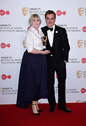 James Nesbitt presents Sarah Lancashire with the award for Best Actress in the press room at the Virgin TV British Academy Television Awards 2017 held at Festival Hall at Southbank Centre, London. PRESS ASSOCIATION Photo. Picture date: Sunday May 14, 2017. See PA story SHOWBIZ Bafta. Photo credit should read: Ian West/PA Wire