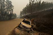 LEIRIA, PORTUGAL - JUNE 19:  A burned car stands on the side of the road after a wildfire took dozens of lives on June 19, 2017 near Castanheira de Pera, in Leiria district, Portugal. On Saturday night, a forest fire became uncontrollable in the Leiria district, killing at least 62 people and leaving many injured. Some of the victims died inside their cars as they tried to flee the area.  (Photo by Pablo Blazquez Dominguez/Getty Images)