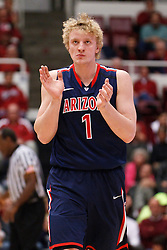 February 3, 2011; Stanford, CA, USA;  Arizona Wildcats center Kyryl Natyazhko (1) reacts to a play against the Stanford Cardinal during the first half at Maples Pavilion.  Arizona defeated Stanford 78-69.