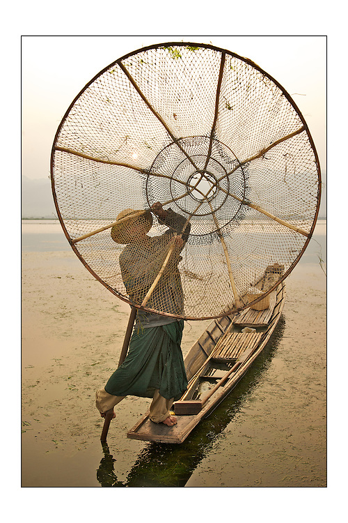 SMALL version - 9&quot;X6&quot; (23X15 cm) <br /> An Inle Lake fisherman shows off his skills. The shallow water of the lake allow the tall conical net to trap fishes inside. A set of special edition prints on offer at a special price to raise money for the earthquakes that devastated Central Italy and Central Myanmar at the end of August 2016. Each print comes with a wide border on fine-art paper ready to be framed on standard size mounts. <br />  I will donate all profits to charities helping the victims of the earthquakes.