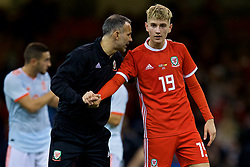 CARDIFF, WALES - Thursday, October 11, 2018: Wales' David Brooks (R) and manager Ryan Giggs after the International Friendly match between Wales and Spain at the Principality Stadium. Spain won 4-1. (Pic by David Rawcliffe/Propaganda)